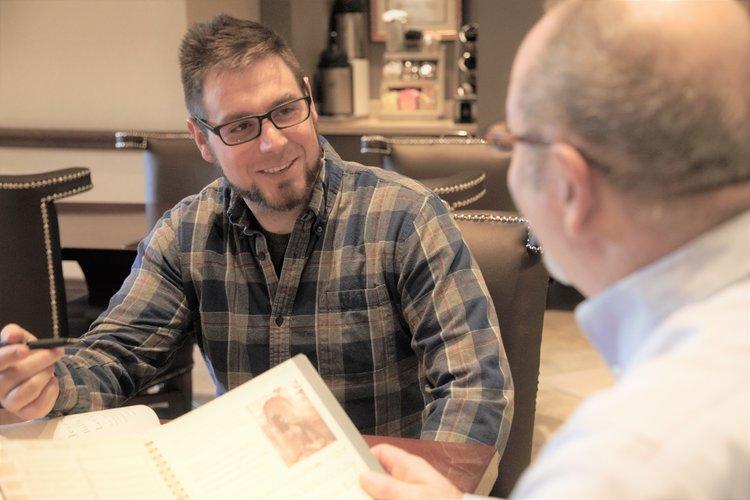 two men meeting around a table going through LPA