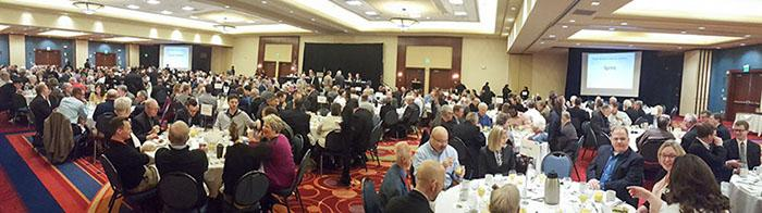 wide shot of group at past OPMPB